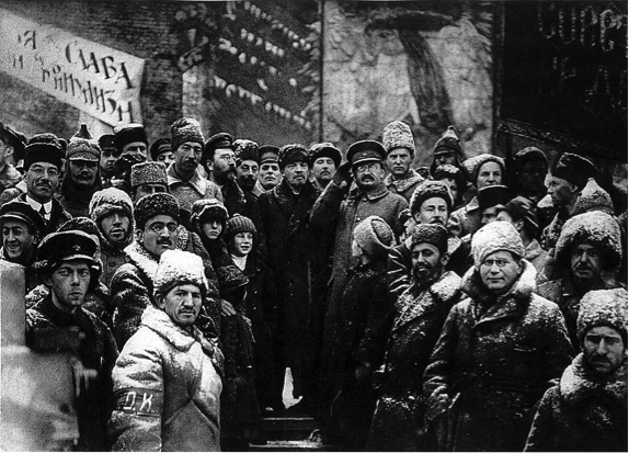Bolshevik leaders, including Trotsky and Lenin, celebrate the second anniversary of the October Revolution.