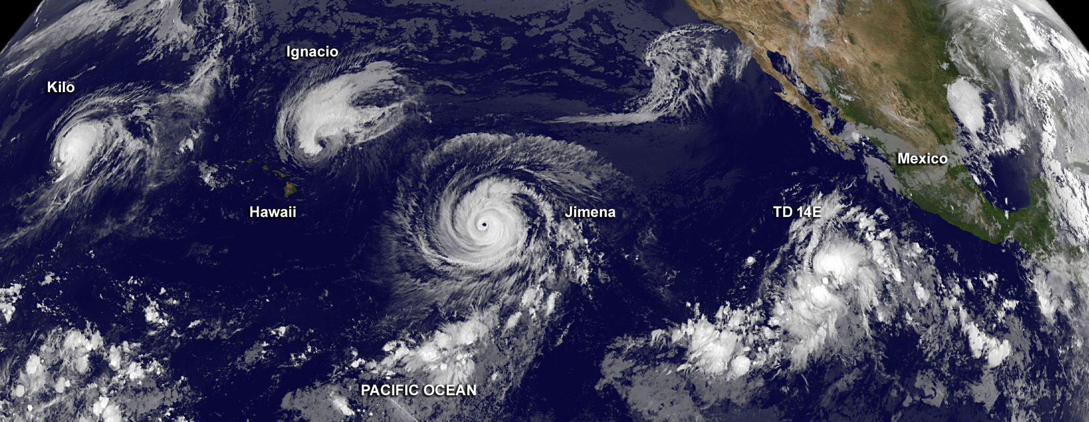 September 2015: The unprecedented formation of three simultaneous category 4 Hurricanes in the Pacific, and another in the Atlantic, marked the peak of the second most intense Pacific hurricane season on record. Image from NASA.