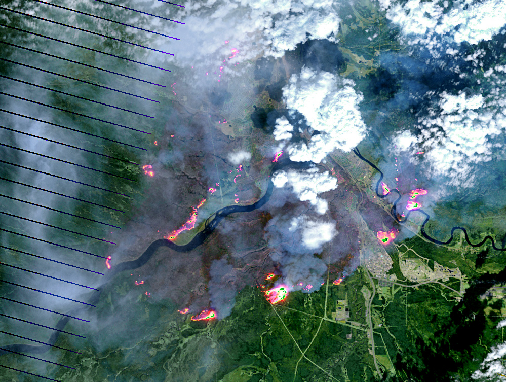 On May 4, 2016, the the Enhanced Thematic Mapper Plus (ETM+) on the Landsat 7 satellite acquired this false-color image of the wildfire that burned through Fort McMurray in Alberta, Canada. The image combines shortwave infrared, near infrared, and green light (bands 5-4-2). Near- and short-wave infrared help penetrate clouds and smoke to reveal the hot spots associated with active fires, which appear red. Smoke appears white and burned areas appear brown. [Credit: NASA Earth Observatory image by Joshua Stevens]